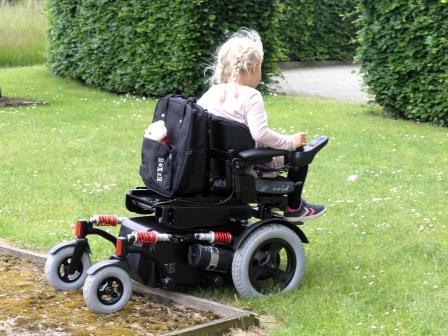 TA iQ Paediatric Power Chair over rough edges